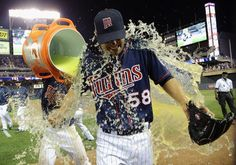 Alexi Casilla #12 of the Minnesota Twins pours Gatorade on Scott Diamond #58 after a win against the Cleveland Indians on July 27, 2012 at Target Field in Minneapolis, Minnesota. The Twins defeated the Indians 11-0.