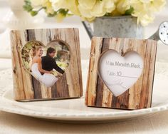 """Faux-Wood Heart Place Card Holder  Features and facts:  Square, resin frame with light, faux wood print and a heart-shaped space for a photo  Black back and frame stand  Photo space is 2 1/8 h x 2 1/8"""" h (in heart shape)  Photo frame measures approximately 3"""" square"""