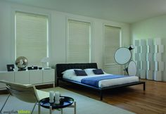 Luxury off white wooden blinds in a contemporary styled bedroom.