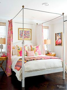 Lighthearted in tone, this mostly white bedroom puts the focus on the cheerful floral print pillows. Part Palm Beach sophisticated, part Hawaiian surfer girl, the fabrics merge the friendliest bright pink with sunshine yellow, and lush green for a carefree, summery island feel./