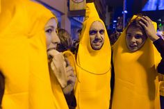 Bohemian Grove. Two bananas look on in disgust at an act of cannibalism. Taken near the Ontario Academy for Art and Design University during Nuit Blanche, a night street art festival that happens in Toronto once a year.