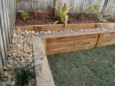 Wooden retaining wall, flat top makes a nice seat - could do this around plantar boxes along back Sloped Backyard Landscaping, Backyard Retaining Walls, Sloped Yard, Landscaping Ideas, Landscaping Shrubs, Railroad Ties Landscaping, Wooden Retaining Wall, Sleeper Retaining Wall, Retaining Wall Steps