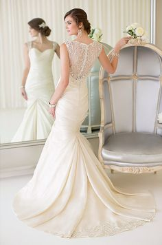 This beautiful fit and flare wedding dress from Essense of Australia features a stunning illusion back with Diamante beading, a sweetheart neckline, a figure-flattering ruched bodice and a flowing skirt with fabric pickups.