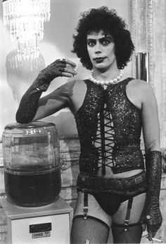 """Tim Curry on break while filming """"The Rocky Horror Picture Show"""" (1975) just hanging by the bourbon cooler looking good..."""