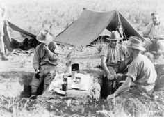 "© IWM (HU 90362) The Advance through Palestine and the Battle of Meggido: Three members of the Imperial Camel Corps take their breakfast from a ""funk hole"" table in the desert near Jaffa in Palestine. The Battle of Megiddo occurred 19-25 September, 1918."