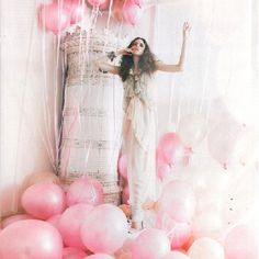 Pink balloons, a beautiful dress, messy hair - simply gorgeous