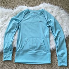 {Nike} Dri-Fit sweatshirt Nike Dri-Fit crew neck sweatshirt. Color: light blue. Size: XS. Front kangaroo pocket and thumb holes. Only worn once- in excellent condition. Nike Tops Sweatshirts & Hoodies