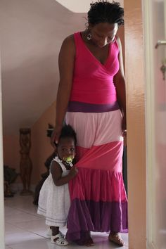Middle Class Mother and daughter in Senegal. - where did the myth start that all africans are poor? that all americans are rich?  that all black people are hungry?  that all white people have more than enough?