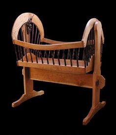 Custom hardwood cradle of black cherry with black walnut leaf carvings