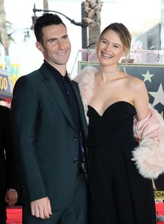 HOLLYWOOD, CA - FEBRUARY 10:  Recording artist Adam Levine (L) and wife model Behati Prinsloo attend his being honored with a Star on the Hollywood Walk of Fame on February 10, 2017 in Hollywood, California.  (Photo by David Livingston/Getty Images) via @AOL_Lifestyle Read more: https://www.aol.com/article/entertainment/2017/02/10/adam-levines-daughter-dusty-rose-steals-the-show-at-his-hollywo/21711707/?a_dgi=aolshare_pinterest#fullscreen