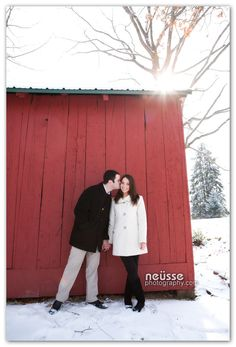 Christen and Andrew Engagement photo session.  lehigh valley wedding photographer. www.NeussePhotography.com. sunshine. kiss. couple potrait. red barn. winter. snow.