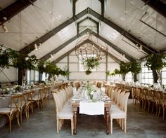 AN INTERESTING SEATING ARRANGEMENT - THREE ROWS OF TABLES IN FROM OF BRIDE AND GROOM, WHY NOT?!
