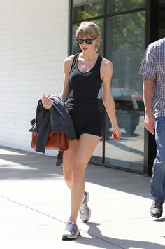 Taylor Swift heads to the gym in little black shorts and tank top