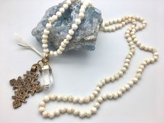 Cheryl Dufault Designs Bone Knotted Mala Necklace with Tuareg Cross and Crystal Point