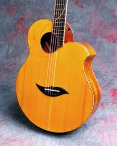 """Fred Carlson,  has been hand-building original and traditional guitars and other stringed instruments for nearly 40 years. As he says: """"Every luthier has their own sound, just as every piece of wood and, of course, every instrument does. I try to work with each design, each piece of wood, to make it as responsive as possible. Ideally, I want an instrument's own, unique voice to be open and unrestrained, with a balance of warmth, brightness and clarity throughout it's range."""
