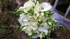 Rose, freesia and calla bridal bouquet