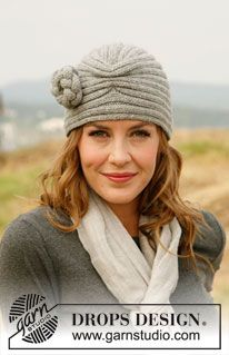 """Knitted DROPS hat with flower in """"Karisma"""". ~ DROPS Design"""