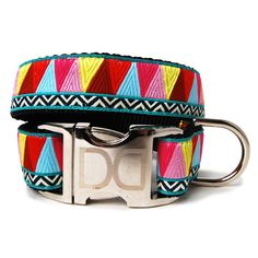 Santa Fe Zig Zag Dog Collar. Add a pop of color to your dog's neck! Featuring multi-colored zig zag triangles, this collar is made of soft nylon overlaid with durable polyester ribbon that is quintuple stitched at stress points for added strength and features an all-metal buckle and D-ring for easy attachment. Made in the USA. Don't forget the matching leash!     Sizing:  M/L: 16-24 in. L x 1 in. W  XL: 24-32 in. L x 1 in. W