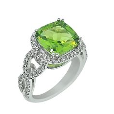 peridot and white gold ring.. I NEED this!! My wonderful husband and our beautiful daughter's birthstone is peridot..