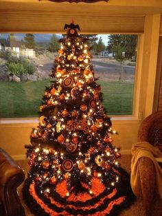 Break out your Christmas tree early and use it as a Halloween tree ...