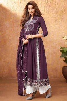 Enhance your ethnic charm by wearing this dark purple rayon trouser suit which will be scene-stealing ethnic wear to shine in the spotlight This collar neck and 3/4th sleeve suit accentuated with thread work. Completed with cotton palazzo pant in white color with dark purple georgette dupatta. Palazzo pant has chikankari work. #trousersuit #salwarkameez #malaysia #Indianwear #Indiandresses #andaazfashion