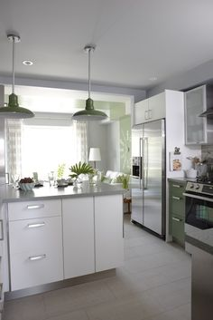 Para Paints Ice Pick  Silver gray walls paint color, green Ikea kitchen cabinets painted Para Paints Outside Influence, gray ceiling painted Para Paints Old Sterling, gray Ikea countertops, Saltillo Tiles gray glass subway tiles backsplash and vintage green pendants.