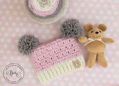 These Dusty Rose Sack Hat is a sweet little hat that is quick to make. The large pom poms adds to the cuteness! Get the free crochet pattern here.