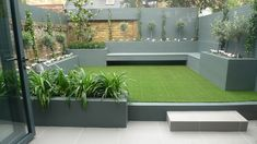 modern small low maintenance garden fake grass grey raised beds contemporary planting marylebone london