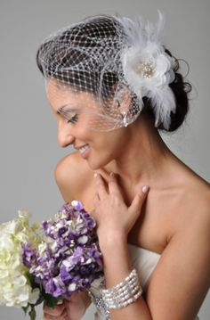 KAT Hair Accessories Veil Bridal Fascinator Birdcage Veil --Birdcage Veil with Beaded Flower & Feathers for Wedding from Camilla Christine. $118.00, via Etsy.