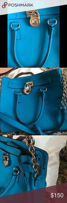 Michael Kors gorgeous nearly new EUC LARGE bag. Aquamarine Hamilton! Beautiful blue color with silver accent. Pictures show wear in 2 places barely noticeable on bottom sides. So approximately priced. Comes with dust bag! Michael Kors Bags Shoulder Bags