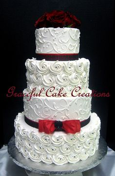 Elegant White Butter Cream Wedding Cake with piped Rosettes and Scrolls decorated with Red Ribbon and Black Rhinestone Mesh Ribbon