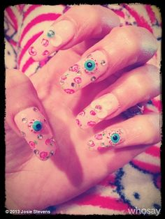 Kooky new nail art for spring- roses, bows, rhinestones & eyeballs :)