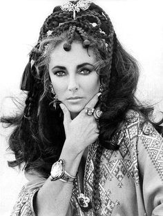 https://flic.kr/p/9Gh7ry   Elizabeth by Gianni Bozzacchi 1969   Taken on the terrace of the Dorchester in London, Elizabeth is wearing a kaftan embroidered with gold and silver thread given to her by the Empress of Iran, Farah Diba. The jewels are Persian. This photograph was sent to the Empress with thanks.