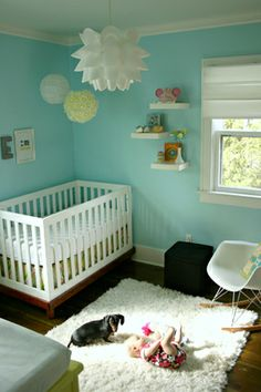 One of my Nursery idea favorites!!! everything looks so lovely..from the lights, to the wall decor and even down to the floor. I love it! I love it! I LOVE IT!!