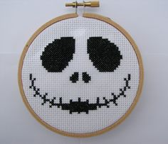 Here is the perfect unique gift for someone who loves Halloween. Jack Skellington, the Pumpkin King, is featured in this hoop cross stitch. This little beauty will be loved and will be an awesome addition to yours or your loved ones collection. The Jack cross stitch is made using black DMC floss that is stitched into 11 count Aida cloth and supported using a wooden hoop. The wooden hoop is 4 1/4 inches across with a metal screw at the top and the item weighs less than an ounce. The back is…