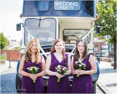 bridesmaids in dark purple dresses with black and cream vintage bus