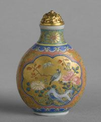 Chinese Snuff Bottle  ~    Roses, Chrysanthemums, and Birds ~   Qing Dynasty (1644-1911), Qianlong Period (1736-1795)  Artist/maker unknown ~   Opaque white glass with enamel and gilt decoration; gilded brass stopper; ivory spoon ~   2 5/16 x 1 9/16 inches (5.9 x 4 cm)