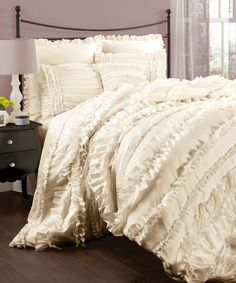 Add new life to your bedroom with this flirty, feminine four-piece woven comforter set. The modern textures of this off-white comforter set brings to mind the beauty of the French countryside while pr