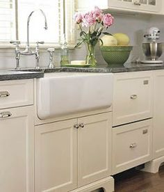 Cream colored cabinets with gray countertops