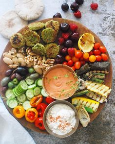 Mediterranean Mezza, a light dinner with some friends. I made some baked herb falafel, a few items from the olive bar, homemade red pepper hummus and Babaganoush, some grilled veggies, cucumber, tomatoes and pita to scoop up everything. Also got a Rosè chilling.