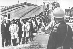 Edmund Pettus Bridge - Just before the marchers are attacked.  Congressman John Lewis in front in white coat.