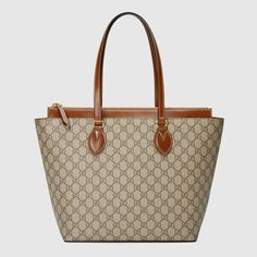 0d4bd692ca7 Shop the GG Supreme medium tote by Gucci. A medium top handle tote with an
