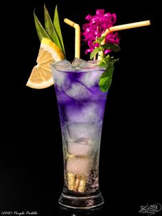 Purple puddle - Curacao blue, Vodka Black Sun, Sprite and Ice. Put ice into glass, pour sprite, and carefully top with curacao and Vodka together. Such a pretty drink.