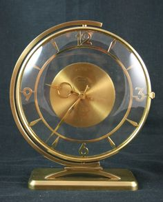An Art Deco modernist clock in bronze and glass with swivelling motion. 8 day movement, marked Bayard to front.    H 20cm, base W 12.5cm    French, circa 1930