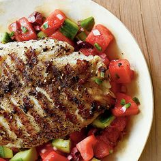 Grilled Grouper with Watermelon Salsa Ready in 21 Minutes This delicious dish is ready in less than 30 minutes! Cool watermelon salsa pairs perfectly with hot-off-the-grill fish. For a twist, serve in a pita pocket for a sandwich. Grilled Grouper, Grilled Seafood, Watermelon Salsa, Watermelon Recipes, Mango Salsa, Seafood Dinner, Fish And Seafood, Fish Dishes, Tasty Dishes
