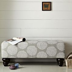 Love this bench from West Elm.  Cute in an entry way or at the end of a bed.