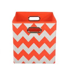 Organize in style with this colorful canvas storage bin. With its bold hue and easy-to-use design, it'll give any room a fun pop -- and hold all of baby's toys, blankets, and more. Perfect for kids' r