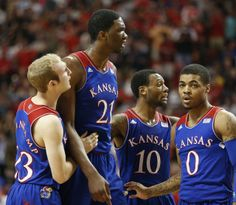 Kansas players Conner Frankamp, left, Joel Embiid, Naadir Tharpe and Frank Mason huddle together after a Jayhawk foul during the first half on Tuesday, Feb. 18, 2014 at United Spirit Arena in Lubbock, Texas. #KU