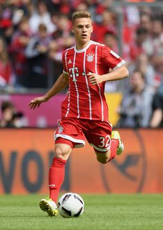 Joshua Kimmich of FC Bayern Muenchen controls the ball during the Bundesliga match between Bayern Muenchen and SC Freiburg at Allianz Arena on May 20, 2017 in Munich, Germany.