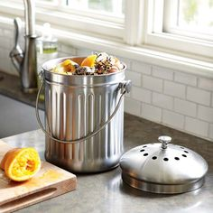 composting - I have a container like this by the sink. Fill it with egg shells, coffee grounds and old vegetables. Add to composter of choice with outdoor organic material such as leaves and grass clippings.